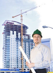 Young Architect standing in front of highrise