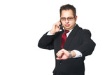 Business man on cell phone looking at watch poster