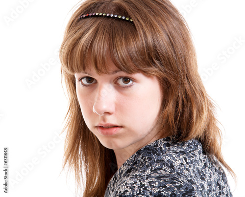 Young girl in summer clothes isolated at the white background