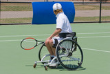 A wheelchair bound athlete on the tennis court poster