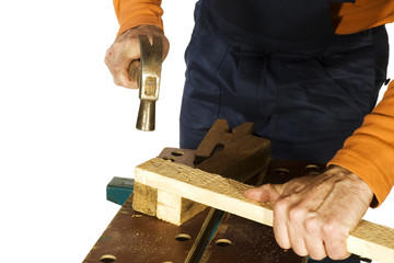making a construction with hammer and nail