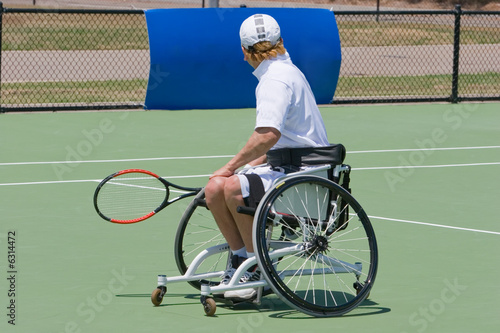 A wheelchair bound athlete on the tennis court