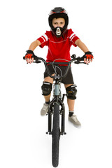 Young boy in helmet and protection kit sitting on BMX