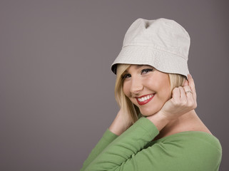 Blonde Holding White Hat Smiling