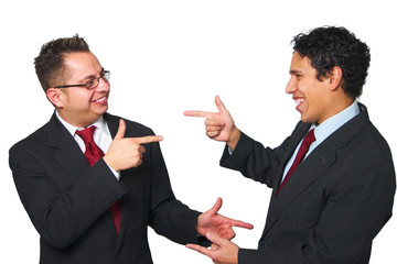 Two men pointing at each other
