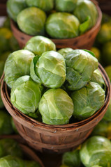 Brussel sprouts for sale in a basket on a open air market stall