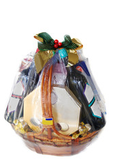 a nicely decorated gift hamper of wines and chocolates