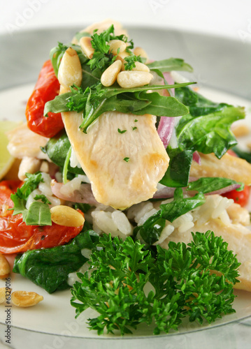 Chicken and pine nut stack with tomatoes and risotto..