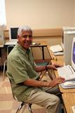 Senior citizen learning computer skills poster