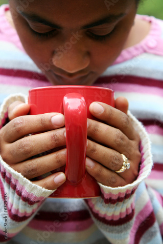 Woman drinking a hot cup of coffee