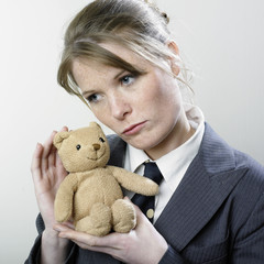 Businesswoman with teddy bear