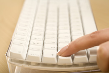 a finger on a keyboard