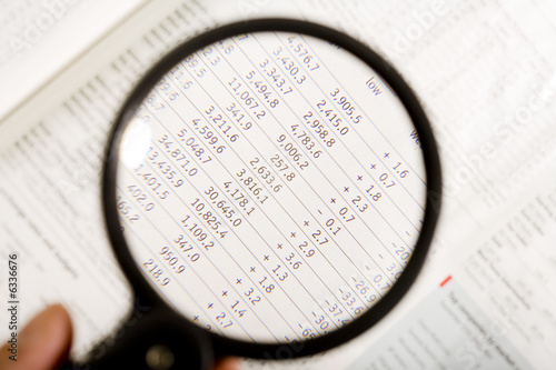 a magnifying glass, financial magazine2