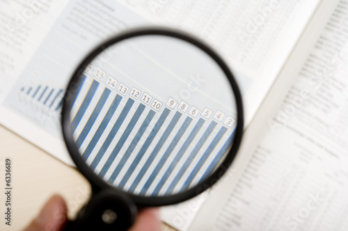 a magnifying glass, financial magazine1