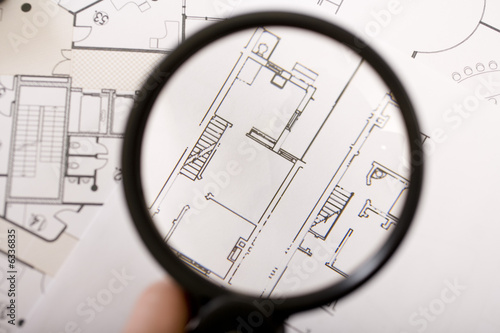 a magnifying glass, a plan
