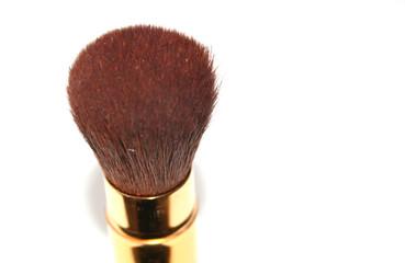 golden make-up brush