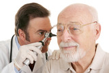 Doctor using otoscope to look in a senior man's ears.
