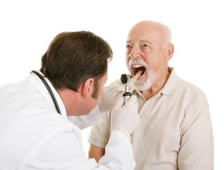 Doctor using a tongue depressor looks in patient's mouth
