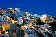 The village of Oia at dusk, on the island of Santorini, Greece