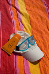 objects of bath posed on a beach towel