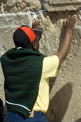 Tourist from Africa prays at the Wailing Wall. Jerusalem.