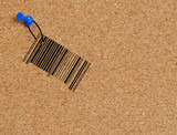 barcode dangling from string fastened to corkboard poster