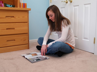 teenage girl reading a magazine