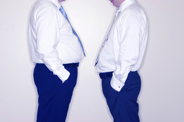 front view of two businessmen standing facing each other