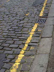 Cobbled street with no-parking stripe