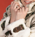 Female hands the fur coats which have clasped a collar poster