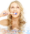 picture of happy blond with toothbrush in water