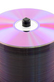 Purple CDs or DVDs on spindle, on white background. No dust. poster