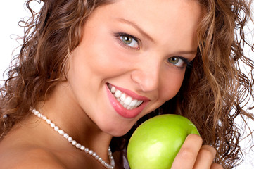 Beautiful young woman eating the green  apple. .