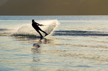 sunset Waterskier sprays water Pittwater  Australia