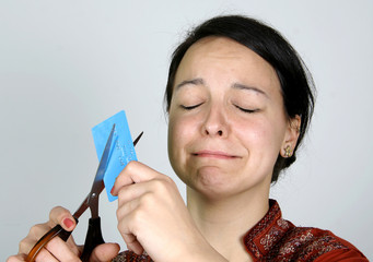lady cutting up her credit card in despair