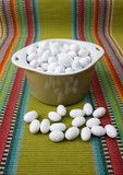 Miniature speckled easter eggs in a green bowl poster