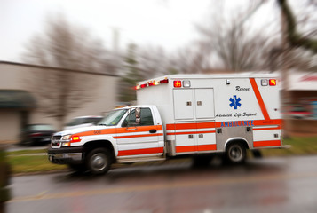 A moving ambulance on it''s way to a crash site.