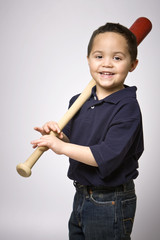 Young hispanic boy with baseball bat