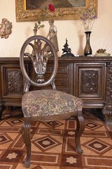 Chair (on chest of drawers background) of XVIII century. German
