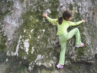 Girl is climbing on huge tree