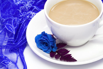 white cup of coffee with blue rose