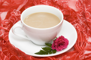 white cup of coffee with red rose