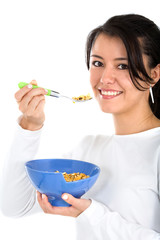 girl eating cereal isolated over a white background