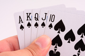 Poker player holding royal flush in hands