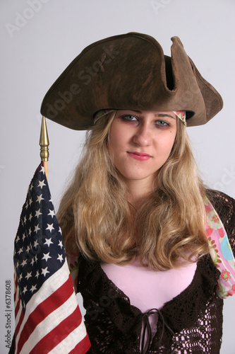 Cute woman with hat and flag