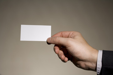 a businessman  holding a business  card 1