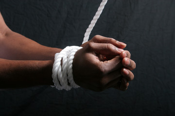 African American man's hands tied
