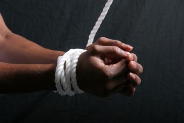 African American man's hands tied