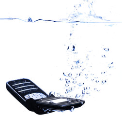 Phone splashing into water - concept for relaxing (copyspace)