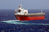 Cargo ship balk carrier maks turn on the sea surface